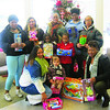 Living Word Church Youth Ministry members Madaja, back left Nikki, Andrea, Malique, Jessie, Kyeanna, Daevion, Sheilla, Sarah and, Wendy donated toys on Saturday.