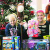 Laila, left, and her sister, Lilly, have been offering food and water for donations at Vermilion's Wooly Bear Parade for the past three years. All proceeds go to buy toys for The Not Forgotten Box.