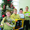 Emanuel Lutheran Boy Scout Troop 110 donated items. Pictured are Devlin Lawhorn, 11, left; Chris Black, 11; Ian Healy, 11; and Joey Nichols, 11.