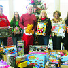 The Lorain County Auditor's Office raised $800 to purchase toys by allowing employees to have dress-down days in December. Picture are Paul Nishinain, left, Jennifer Kelleher, Craig Snodgrass, Kathryn Karpus, Annie Croft and Heidi Folley.