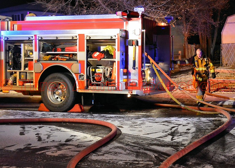CSFD Engine 7 with dual supply lines attached, and two fire attack lines on the ground, for a residential structure fire on Kern Circle. 12/22/2014