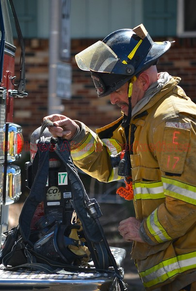 A CSFD Fire Engine 17 Firefighter on the scene of a working house fire on Palmer Park Boulevard. March 29, 2015