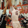Elyria Damon Stewart puts the ball in over Normandy Jaret Colovas Jan. 18.  Steve manheim