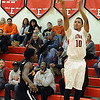 Elyria Isaiah Walton shoots 3 pointer over Normandy Terrance Hogan Jan. 18.  Steve manheim