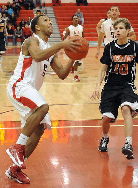 Elyria Dontae Dukes goes to hoop by Normandy Petey Zaremba Jan. 18.  Steve manheim