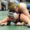 North Ridgeville's Nick Bailey, top, loses to EC Adam Kuchta in 220 wt. class on Jan. 11.  Steve Manheim