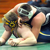Elyria Catholic Adam Kuchta , top, defeats North Ridgeville Nick Bailey in 220 wt. class Jan. 11.   Steve Manheim