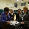 Poll workers, from left, Barbara Kasbarian, Janet Hovious, LeReine Frampton, and Carol Mattegat print a ribbon from the voting machine Tuesday after 8 pm, minutes before read-ing the results of a failed budget for both the Board of Education and Board of Selectmen.  (Bobowick photo)