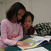 Mother and daughter Victoria, left, and Po Lau worked together at Hawley Elementary School on Monday, May 13, during a poetry workshop.   (Hallabeck photo)