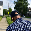 "Wearing a ""Man of Faith"" hat with ""JESUS"" on the back strap, Steve Simmelkjaer, 64, of Erie, walks along Wallace Street in Erie on May 27. Simmelkjaer is the coordinator of the East Side Eagles neighborhood watch group and the chairman of the Erie Neighborhood Watch Council. Part of his neighborhood is located in a part of Erie's east side that had experienced the most violent crime so far in 2014."