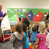 JULIE CROTHERS   THE GOSHEN NEWS<br /> Kindergarten teacher Jared Knipper leads his class in a celebratory dance on the first day of school Tuesday at Syracuse Elementary School.