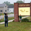 SAM HOUSEHOLDER   THE GOSHEN NEWS<br /> Christina Mullet takes a photo of her son Lucas, 5, while daughter Lilly, 6, looks on. Lucas began kindergarten and Lilly first grade at Shipshewana Scott Elementary School Tuesday.
