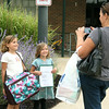 JULIE CROTHERS   THE GOSHEN NEWS<br /> Sisters Delaney and Addison Delagrange pose for a photo taken by mom Celia Delagrange in front of Syracuse Elementary School on the first day of school. Delaney is a third grader and Addison began her first day of kindergarten on Tuesday.