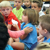 JULIE CROTHERS   THE GOSHEN NEWS<br /> Annabelle Rogers is comforted by a classmate on her first day of kindergarten Tuesday at Syracuse Elementary School. It wasn't long before Rogers was up dancing with her classmates in Jared Knipper's kindergarten class.