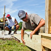SAM HOUSEHOLDER | THE GOSHEN NEWS<br /> Goshen Parks Department employees Kevin Yoder, right and Ron Suggs, work on a platform at Mill Street Park Wednesday. The new Goshen park on the former Quality Drive-Away site does not have a completion date yet.