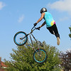 JOHN KLINE | THE GOSHEN NEWS<br /> Brandon Wolferman of Syracuse performs an aerial trick during a BMX Jump Show by Solution Action Sports of Muncie during the 23rd annual Ligonier Marshmallow Festival Sunday afternoon.