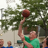 SAM HOUSEHOLDER   THE GOSHEN NEWS<br /> John Ellinger, of Middlebury, shoots the ball during a basketball game between ADEC and Grace Community Church members at First Friday SandBlast.