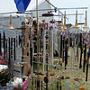 DENISE FEDOROW   THE GOSHEN NEWS<br /> A selection of wind chimes made from old band instrumentsare shown. The artist, John Parker, is shown to the left of photo.