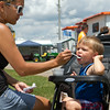 SAM HOUSEHOLDER | THE GOSHEN NEWS<br /> Tiffany Tarlton, of Pierceton, assists son Drake, 2, in eating some ice cream at the Kosciusko County Fair Wednesday in Warsaw.