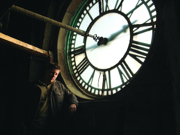 SCOTT WEISSER | The Goshen News Blake Eckelbarger stands near one of the clock faces inside the Elkhart County Courthouse in Goshen Sunday morning. Eckelbarger has maintained the courthouse clock since 2000.