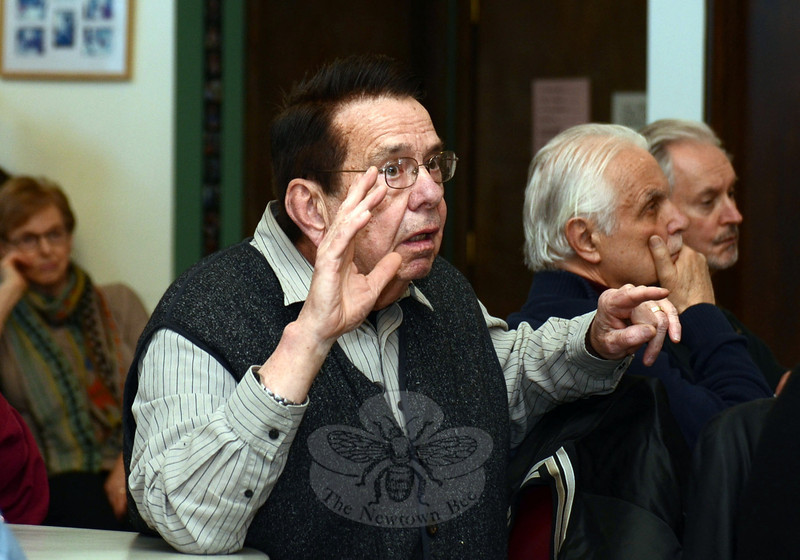 Resident Ray Baker questions town officials during an information forum on the updated senior tax relief ordinance Wednesday evening at the Newtown Senior Center. The new updates will be deliberated following a scheduled Legislative Council public hearing May 7.  (Voket photo)