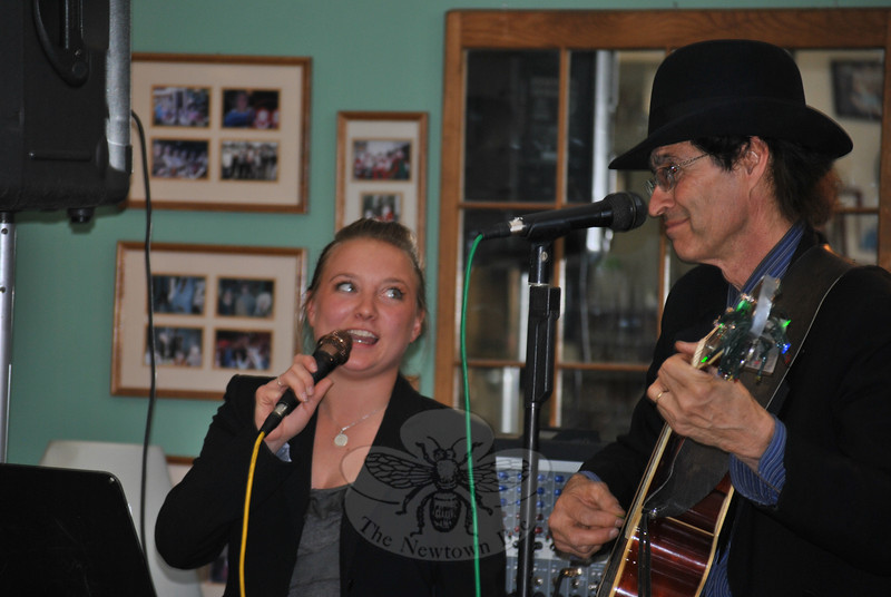 Stephanie Paproski adds her voice to Billy Michaels's guitar playing during a set of country songs, Thursday, April 10, to the delight of the crowd at Newtown Senior Center. (Crevier photo)