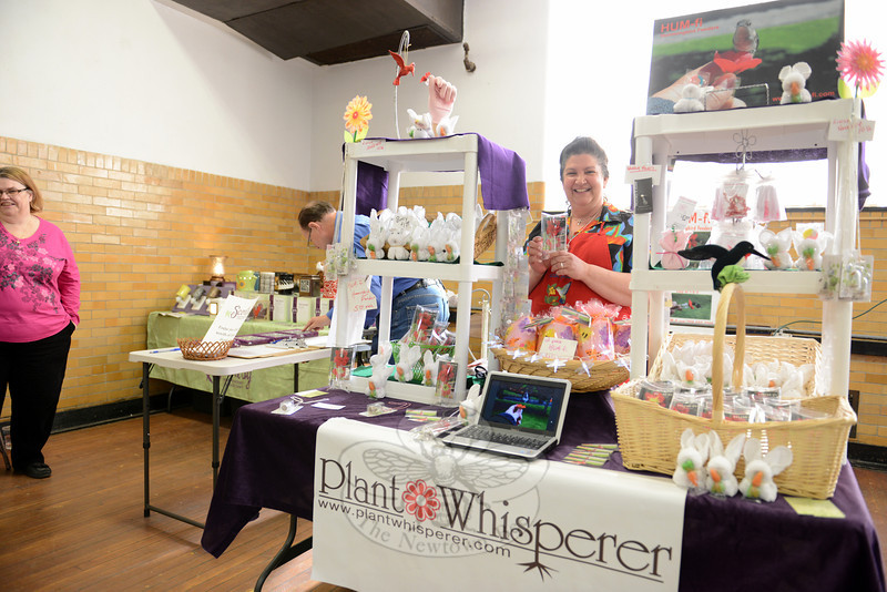 Lisa Durante with Plant Whisperer out of Thomaston displays a variety of good including mini desert plants in tiny glass vials. She also had her hand-held hummingbird feeders, Hum-Fi for sale. (Bobowick photo)
