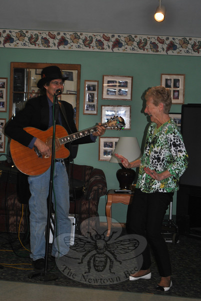 Senior Center member Beverly Panitteri shows off her dance moves, with some encouragement from musician Billy Michaels. (Crevier photo)