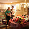 "The Newtown Fund is preparing for Delivery Day, the culmination of its annual Holiday Basket Program during which families in need are provided gifts and other items that will make their lives brighter. Since 2008, Sandy Hook resident Rosemary Trudell, left, with granddaughter Haley, has organized a collection of toys and children's clothing among the residents of Walnut Tree Village II. Her granddaughters have always helped with collecting and organizing the items for her, but older grand-daughter Julia is at college this year and unable to help for the first time. The dining room table of the condo where Leslie and George Trudell live was filled to overflowing on Wednesday, December 11. Many of the Trudells's neighbors were able to donate plenty of toys, books, games, and even clothing again this year. ""The Newtown Fund asked for lots of presents for teenagers this year,"" said Mrs Tru-dell. ""I think they'll be very happy with what we will be sending over."" Delivery Day is Saturday, De-cember 14, at Fraser-Woods School. Residents who would still like to participate with donations of gifts and household items to help others get through the holiday season are urged to contact Layne Lescault at 203-270-6481 as soon as possible. (Hicks photo)"