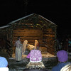 After being postponed due to snow on Saturday, December 14, a small crowd gathered around St Rose of Lima's Living Nativity scene on Sunday, December 15, following the 5 pm mass. The living nativity display is a popular Christmas season tradition at St Rose.	(Hallabeck photo)