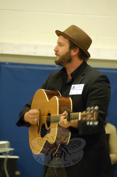 "Tim Warren, band member of The Alternate Routes, sang the band's song ""Nothing More"" with Hawley staff and students during the December 13 sing-along. (Hallabeck photo)"