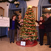 Promoting the first of what will be an Annual Giving Tree to benefit community members in need, from left, are Newtown Prevention Council grant coordinator Kim Killoy and council co-chair Judy Blanchard, Edmond Town Hall Board of Managers Vice Chair Margot Hall, and board member Jim Juliano. The tree stands in the lobby at Edmond Town Hall. (Bobowick photo)