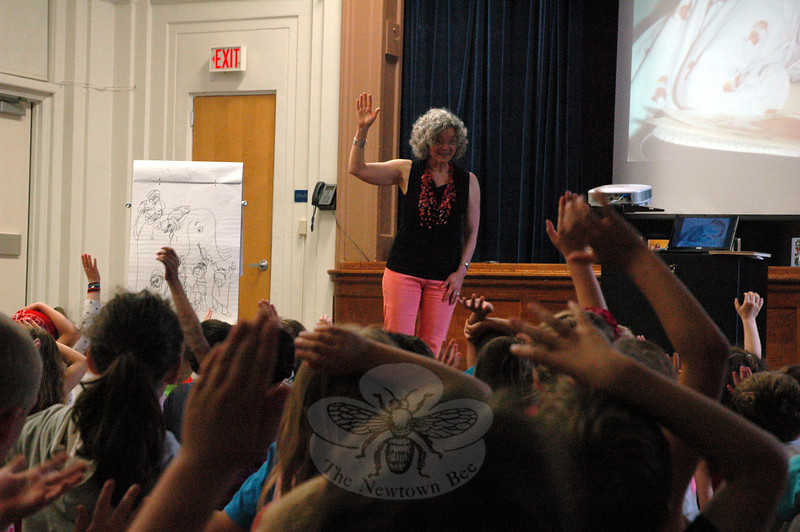When author and illustrator Barbara McClintock visited with Hawley Elementary School on Friday, June 6, she asked students to swear, with their hands in the air, they would never draw on their refridgerators. Parents, she said she knows from experience, never forget such a practice.