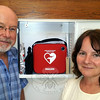Newtown Volunteer Ambulance Corps Chief Michael Collins and Newtown Health District Director Donna Culbert show off one of the newest generation automatic external defibrillators that were recently installed at several town locations. The AEDs are designed to provide lifesaving monitoring and if necessary, electrical shocks to restore heart rhythm to cardiac arrest victims by untrained personnel until trained medical responders arrive on scene.  (Voket photo)
