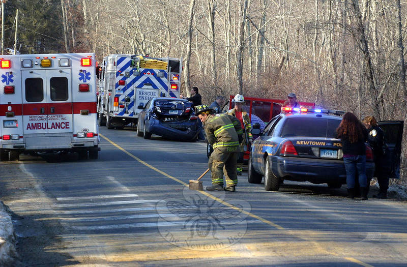 Police, Dodgingtown volunteer firefighters, and Newtown Volunteer Ambulance Corps members responded to a two-vehicle accident about 4 pm on Saturday, March 8, on northbound Key Rock Road, just north of its intersection with North Branch Road. Police said that motorist Kimberly Scavetta, 33, of Bristol, who was driving a 2007 Toyota Camry sedan, was slowing for a speed bump, when the Toyota was struck from behind by Jakob Honig, 31, of Seymour, who was driving a commercial 2000 Dodge Dakota pickup truck that was hauling a trailer. Police said that Scavetta and Toyota passenger Eric Davis, 45, Bristol received possible injuries. Police report they issued Honig an infraction for a traffic violation. (Hicks photo)