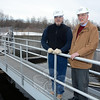 Richard Zang, chairman of the town's Water & Sewer Authority, right, and Julio Segarra, United Water's project manager for sewer system operations, are shown on a catwalk above a secondary clarifier tank at the Commerce Road sewage treatment plant. Mr Zang has written a history on the town's two sewer systems. (Gorosko photo)