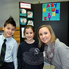 St Rose of Lima students, Tyler Griffin, right, and Nora Kliczewski, center, stand with teacher Gabriella Danieli while projects for the school's Invention Convention were on display, Thursday, February 27. (Hallabeck photo)