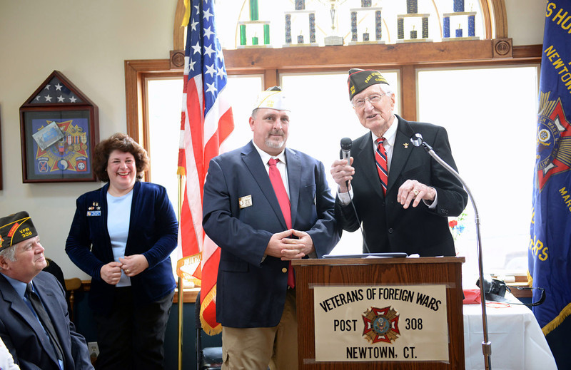 Past state commander (1960–61) Edward Zamm, right, attended the VFW's 75th anniversary celebration Sunday, March 2, presenting members with a citation for the years of service. Welcoming Mr Zamm was post Commander James Rebman, left, and post member Donna Monteleone Randle, background. (Bobowick photo)