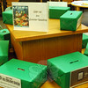 After reading five books while participating in C.H. Booth Library's Summer Reading Program, children can enter their name into a raffle box, from which they can win a number of prizes. While children win prizes, librarians are encouraged by the idea that young children are making a connection with books early in their lives through the annual program. (Gaston photo)