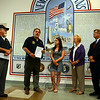 The VFW Post 308 scholarship award winner this year is Alison Forger, left. Presenting her with the award are First Selectman Pat Llodra, center, and Monroe First Selectman Stephen Vavrek. (Bobowick photo)