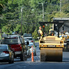 Paving crews were at work putting down a new asphalt surface on Sugar Street (Route 302) on Wednesday, August 20. Signal crews allowed alternating one-way traffic to pass through the area as paving was underway. This view of the paving project looks westward toward Sugar Street's intersections with Juniper Road, Madison Drive, and Baldwin Road. (Gorosko photo)