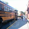 Newtown Middle School students stepped off their bus to go to school for the start of the 2014-15 school year Tuesday morning. (Hallabeck photo)