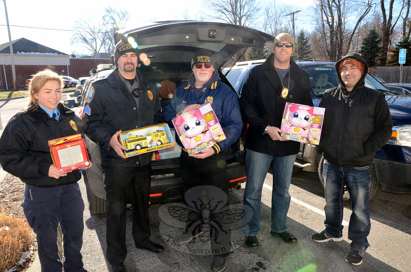 Newtown Police, local Explorers, and colleagues from the Redding Police Department all converged Saturday, hosting a toy drive at the Toy Tree shop on Church Hill Road, while a few hundred feet away, stuffing a cruiser as well as a Redding Police Humvee full of food donations to be shared with hungry families in both communities. Participants in the annual toy drive included Newtown Explorer Allison Sylkowski, Sergeant Matthew Wood, Officer Robert Haas, Officer William Chapman, and Youth Officer Lenny Penna. (Voket photo)
