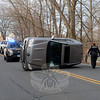Motorist Maria Rocha, 67, of Huntington was driving a 2005 Mercedes-Benz ML-350 SUV northward on South Main Street, just south of its intersection with Mile Hill Road, at about 2:35 pm on December 12, when she briefly closed her eyes and drove off the right road shoulder, police said. The vehicle  then returned to the northbound lane, where it flipped onto its left side, police said. There were no injuries. Rocha received a infraction for making a restricted turn, police said. (Voket photo)
