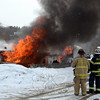 Flames pouring from all windows and the door of a residence at Meadowbrook Terrace Mobile Home Park greeted firefighters around 9:30 am Tuesday. As black smoke billowed into the sky, firefighters fought to knock the fire down. The mobile home was destroyed but resident Frank Rocca, Jr, and his dog were both able to escape without injury. The fire marshal on Tuesday said he believed the fire began in the area of the dwelling's furnace. (Voket photo)