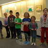 """Head O' Meadow Elementary School students who participated in this year's PTA-sponsored Reflections Program were awarded on Wednesday, January 14. This year the art competition asked entrants to interpret the theme, """"The World Would Be A Better Place If"""" in one of six categories: literature, visual art, video production, photography, dance choreography, and musical composition. Students who participated in the program at Head O' Meadow this year, from left, are, Warren Ache, Isabella Marino, Nicholas Tetreault, Mark Maurath, Riley Powers, Kiersten Daigle, and Logan Johnson. All the students submitted visual arts entries. Mark and Riley received the top placements for their school, and earned trophies. Mark and Riley's work will now advance through the Reflections Program to the state level. (Hallabeck photo)"""