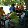 Dickinson Day Camp campers hung out under the pavilion Friday, July 18, where they played a number of board games. (Gaston photo)