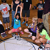 Lucia Rodriguez, 10, celebrates her robot's success, as it pushes another out of the marked circle. (Crevier photo)