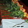 Roses dyed orange, the color chosen to represent the value of human life, cover the banner of support outside of NUMC, after Sunday evening's vigil. Participants were each given a rose as they exited the sanctuary, and asked to place it on the banner. (Crevier photo)
