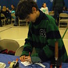 """Hawley Elementary School student Alex Rodriguez worked to inspect his own fingerprint at the """"Magnify This"""" station, offered through EverWonder Children's Museum, at Hawley's STEM Night, held on Wednesday, March 4. (Hallabeck photo)"""